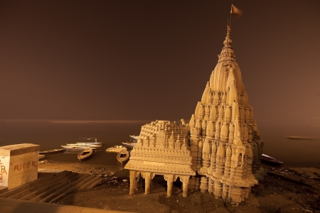 broken temple in ganges river at night time, Varanasi, India photo