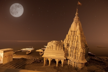 broken temple in ganges river at night time with moon shining and stars, Varanasi, India photo