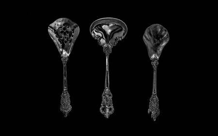 tablespoons on a dark background. the view from the top