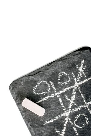 game TIC TAC toe on a black stone. the view from the top