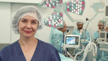 Surgical nurse shows her thumb up Фото со стока