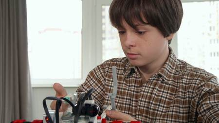 Little boy discourages by toy vehicle assembling