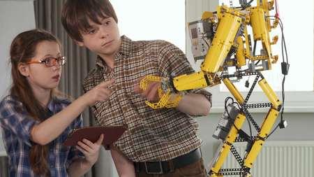 Children check the toy robot 写真素材