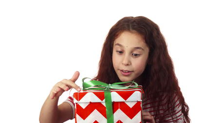 The surprised girl is delighted with her gift Stock Photo