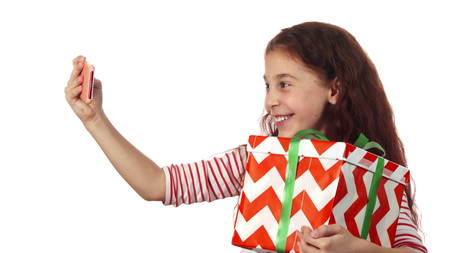 A nice girl makes selfie with her gift