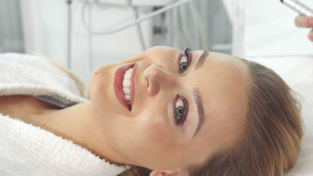 Female client gets ultrasonic cavitation procedure Stock fotó