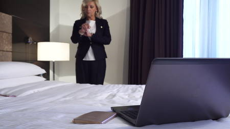 Serious woman going to a business meeting Standard-Bild