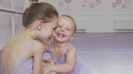 Adorable little ballerinas having fun at ballet school 写真素材 - 132061341