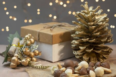 Christmas pastries, cookies mushrooms with cinnamon. Gift boxes with winter gold details Stock Photo