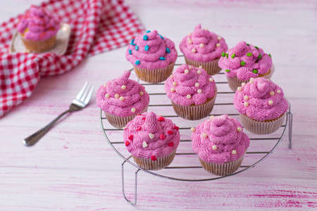 beautifully decorated with cream muffins on a stand. cupcakes