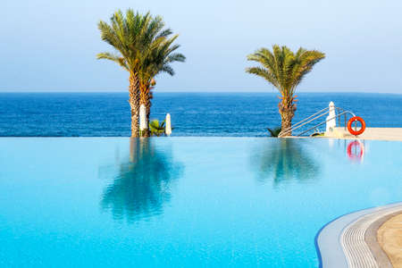 Outdoor tourism landscape. Luxurious beach resort with swimming pool Stock Photo