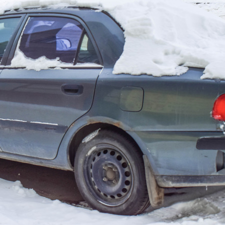 Car was covered with snow. Car in disrepair. He has long been in the parking lot Reklamní fotografie