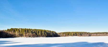 Most beautiful winter landscape photos. Blue sky and winter forest. Stock Photo