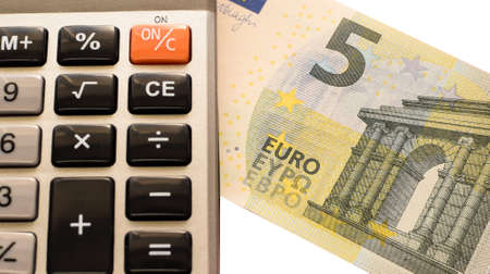 Calculator and euro isolated on white background.