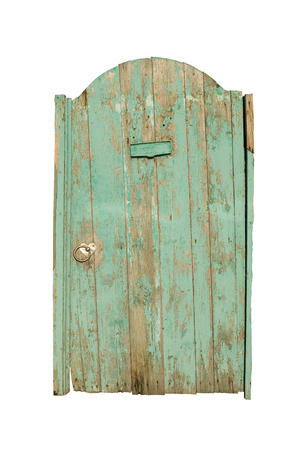 Old wooden door. Cracked green paint on the gate. A high resolution. Stock Photo