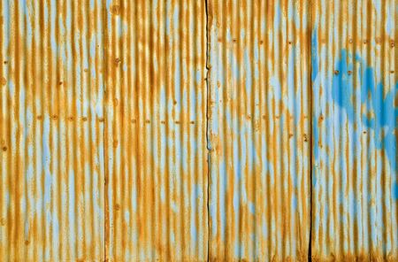 Rusty fluted metal background. A high resolution.