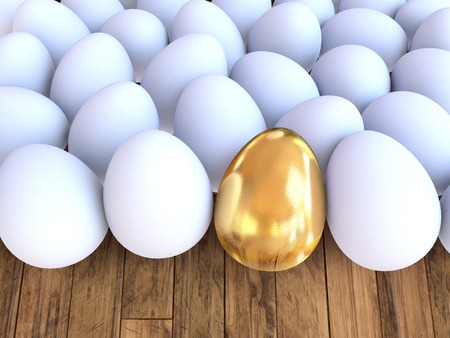 high resolution: White eggs and one golden egg on wooden background. A high resolution.