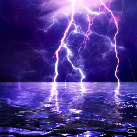 A lightning strike at night over the sea. Reflection of lightning in water. A high resolution. Stock Photo