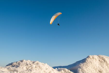 the snowy mountains: hang gliders and peaks of snowy mountains