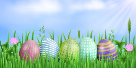Spring easter rectangular background. Painted eggs, blue sky, sun rays, fresh green grass, flowers and clover leaves. Vector concept. Stock Illustratie