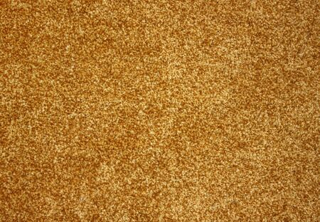 Beautiful gold carpet. Background, texture.