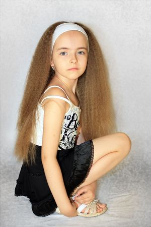 nude little girls: Girl with long wavy hairs Фото со стока