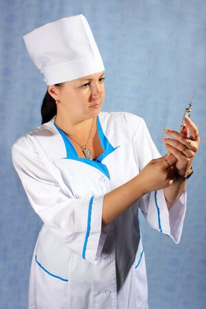 prick: Woman doctor with a prick. Stock Photo