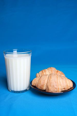 pasteurized: Milk in glass and croissants in a saucer. Stock Photo
