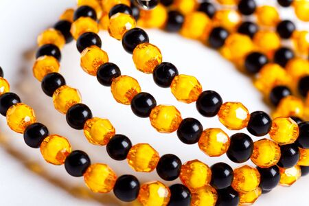 Yellow and black facet beads. photo