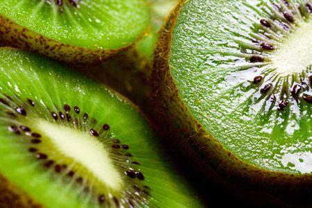 Background is a fruit of kiwi.