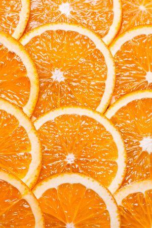 Background juicy parts of orange by rings. Stok Fotoğraf
