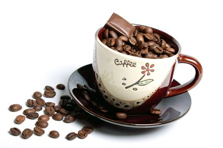 Beans of coffee and chocolate in a coffee cup. Stok Fotoğraf