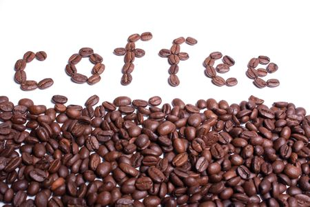 Coffee word written from coffee beans on a white background. Stok Fotoğraf