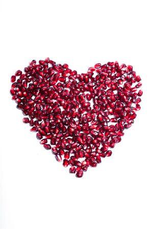 Seeds pomegranate as heart sign. Stok Fotoğraf