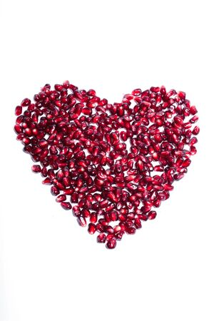 Seeds pomegranate as heart sign. photo