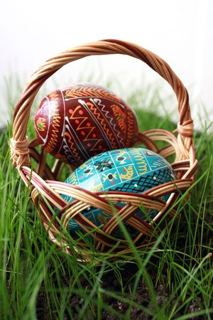 Easter eggs in a basket on a grass photo