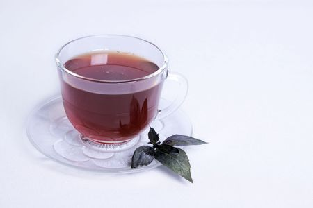 Cup of tea with a mint leaf on a white background. Stock Photo - 6590224