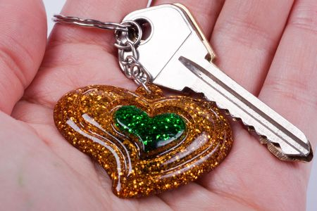 Keys of the house with ������� in the form of heart in a hand. photo