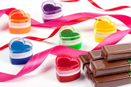 Stamp the press heart with satiny tapes and chocolate. photo