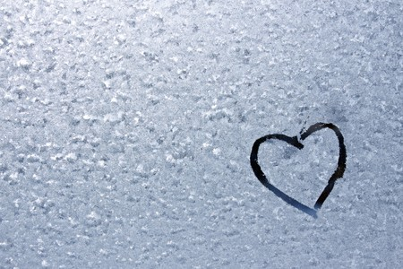 Drawn heart on a frosty pattern Stock Photo - 7844328