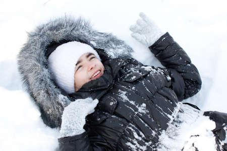 fur hood: Beautiful girl in snow. Stock Photo