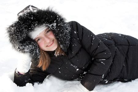 Beautiful girl in snow. photo