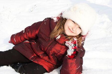 Beautiful girl in snow. photo