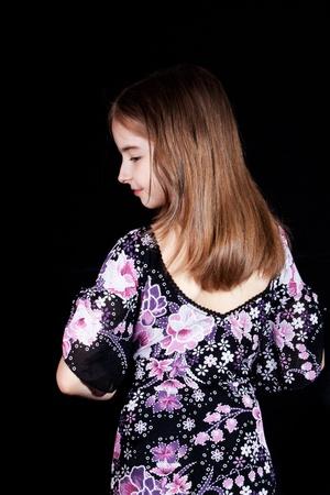 The stylish girl in an elegant silk dress. photo