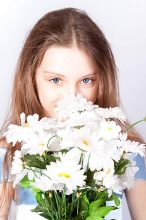 The girl the princess with a bouquet of camomiles. photo
