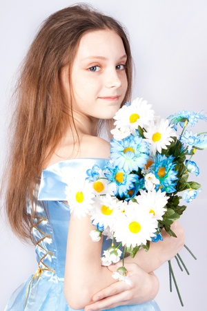 The girl the princess with a bouquet of camomiles.
