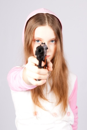 The girl with a pistol. photo