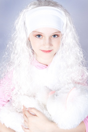 girl in a wig with a toy cat. Stock Photo - 9404598