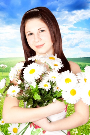 Young Woman Hugging Flowers photo