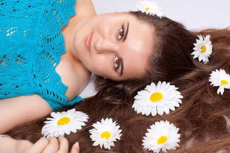 Beautiful sexy girl with a flower in hair. photo